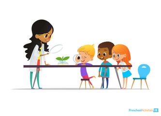 Female teacher demonstrates plant in flask, kids look through magnifier at it during botany lesson. Preschool educational activities and natural sciences education. Vector illustration for website.