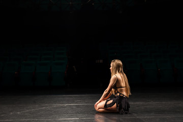 female actress alone on stage