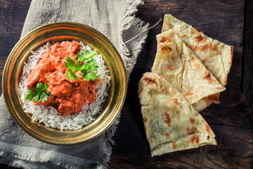 Tikka masala with rice and chicken served with Naan bread