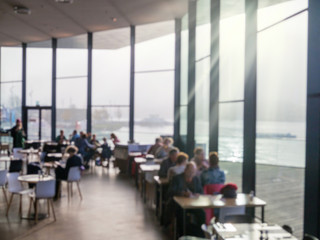 Blurred cafe, and restaurant with sea view and sun light