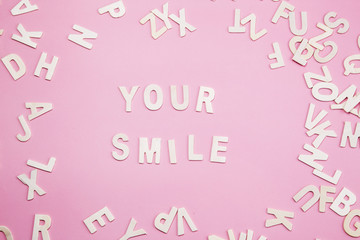 Sorting letters Your smile on pink.