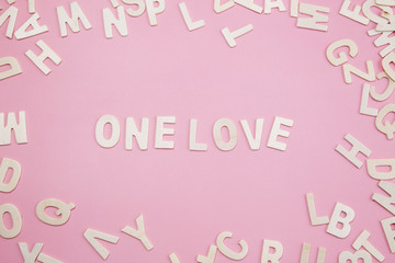 Sorting letters One love on pink.