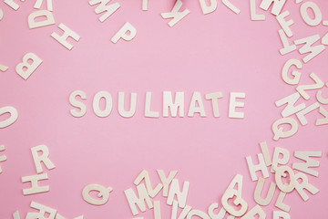 Sorting letters Soulmate on pink.