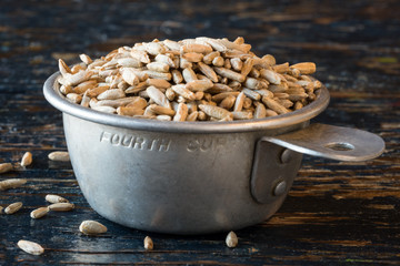 Rye berries in a vintage measuring cup