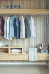 Shirts and jackets hanging in wardrobe