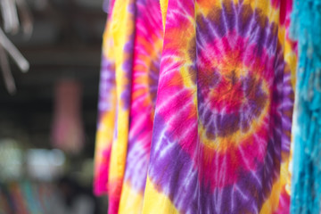 Multi-colored Batik fabric. Tie dye fabric. dry clothes in the sun