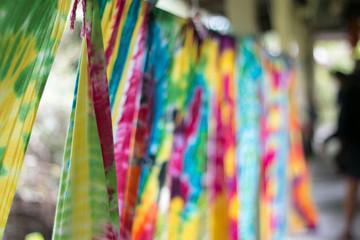 Multi-colored Batik fabric. Tie dye fabric. dry clothes in the sun