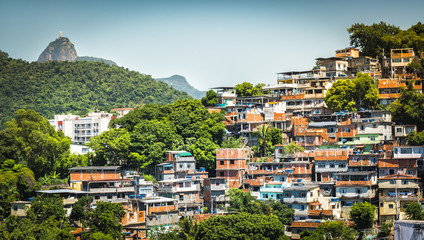 Christ looking at Favela (Shanty Town) in Rio De Janeiro, Brazil