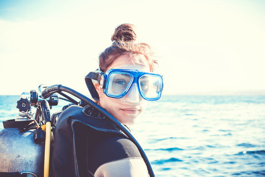 Portrait of a young girl diver on a sunny day
