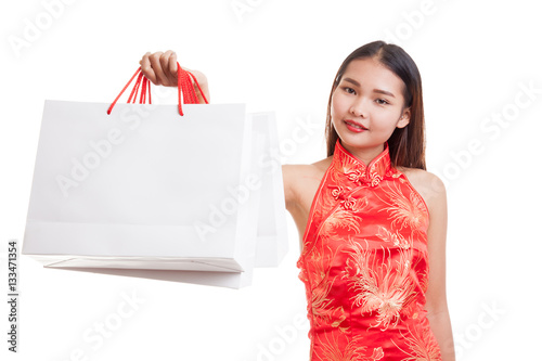 5743a75d0 Asian girl in chinese cheongsam dress with shopping bag.