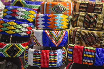 African bright colorful beads bracelets. Local market. Fashion accessories.