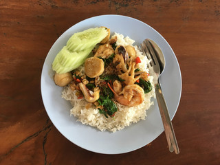 Spicy sea food and basil leaves. Served with rice, Thai traditio