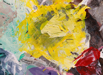 Original acrylic colors on palette. Abstract art background. Fragment of artwork. Brushstrokes of paint. Colorful texture.