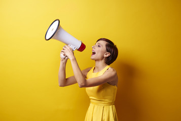 Female model using bullhorn in photo session