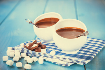 hot chocolate with marshmallows in a cup on a wooden table, selective focus, copy space