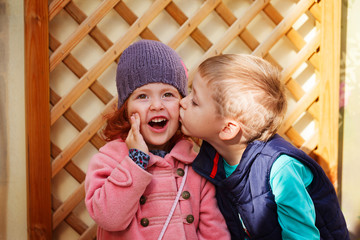 Little boy kissed for the first time adorable little girl. Love and romantic concept
