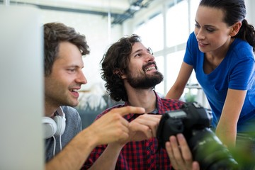 Team of graphic designers looking in camera