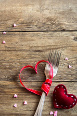 Two forks and red hearts