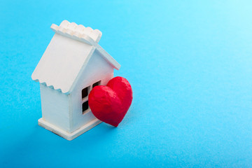 Red heart and white house. Sweet house. Blue background