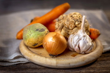 Basic ingredients for cooking on wooden background