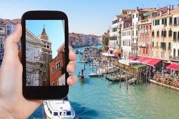 tourist photographs buildings in Venice city