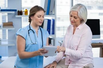 Doctor showing prescription to patient