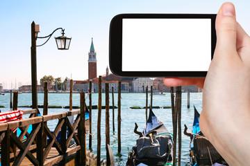 tourist photographs gondolas in Venice city