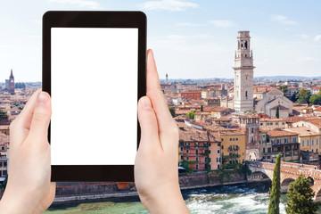 tourist photographs Verona city on tablet
