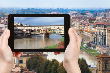 tourist photographs Ponte Vecchio in Florence