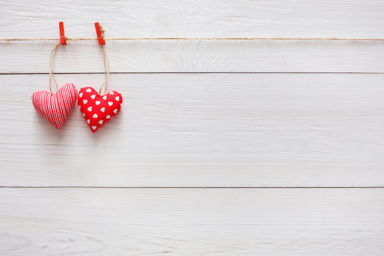 Valentine day background, pillow hearts couple on wood, copy space