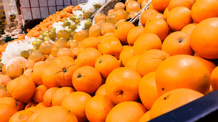 Group of fresh organic oranges in a marketplace