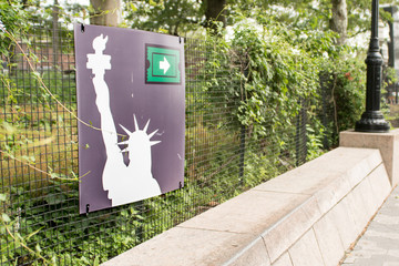 Statue of Liberty sign in Battery Park, New York City