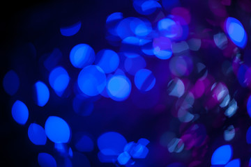 Blue bokeh abstract on black background