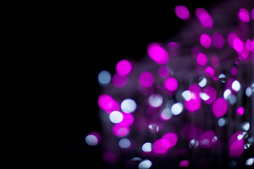 Pink and white bokeh on black background abstract