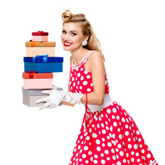 woman in pinup style dress with gift boxes