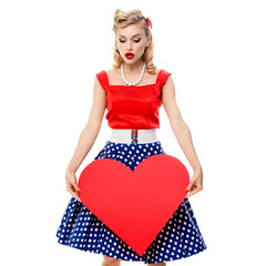 woman holding heart symbol, in pin-up style