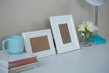 Picture frames, coffee cup with and flower vase