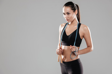 Sporting woman with skipping rope
