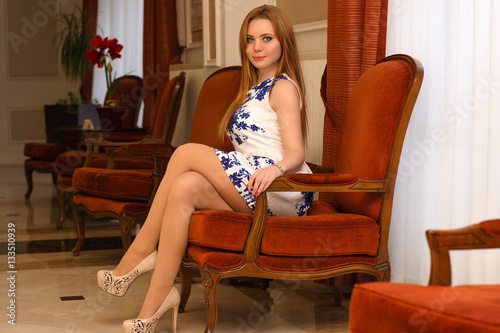 Sexy Charming Woman Sitting On Chair With Legs Crossed Stock Photo And Royalty Free Images On Fotolia Com Pic 133511298