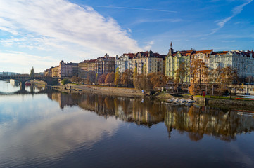 Coastline in Prague. Vltava in warm autumn light cloudy morning