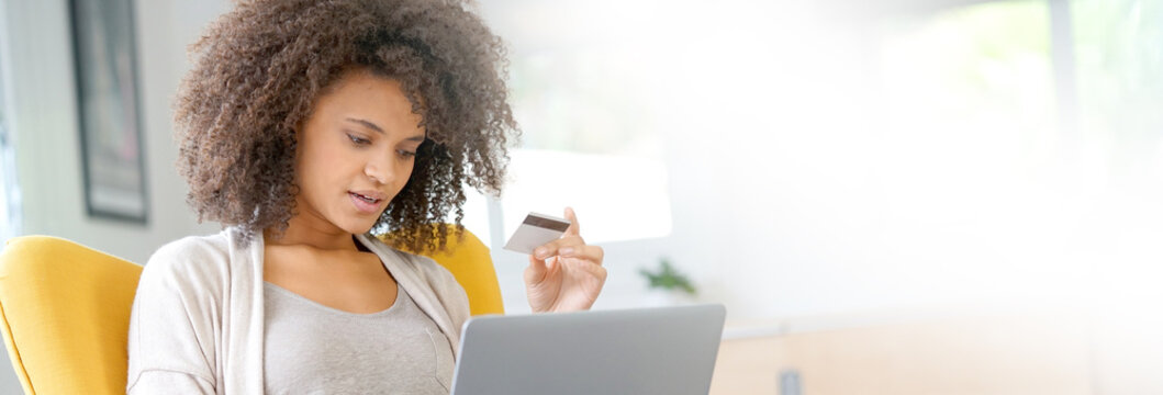 Beautiful mixed-race woman shopping on internet