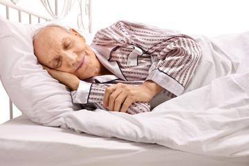 Senior sleeping in bed