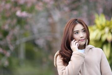 Asian woman selfie with cherry blossom sakura