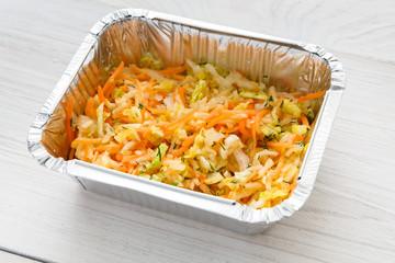 Healthy food take away in foil box, celery salad
