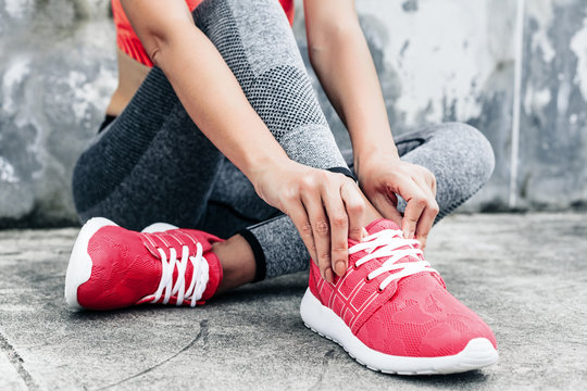 Woman in sports clothing and shoes