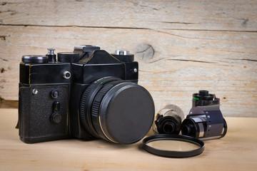Vintage SLR camera on wooden desk
