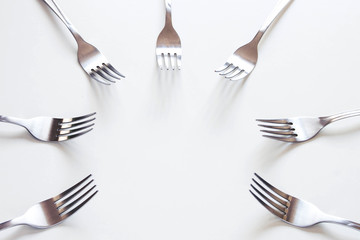 Silver fork neatly on a white table