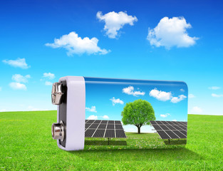 Battery with solar panels in grass. The concept of sustainable resources.