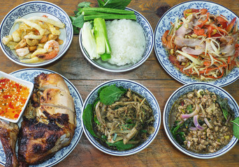 set of thai food, spicy salad, roasted chicken, sticky rice
