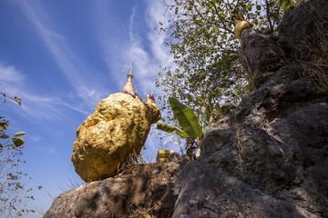 "Amazing golden Buddhist pagoda on the cliff ""Phra That Hin Kew"" Ban Wang Takian, Mae Sot, Thailand"
